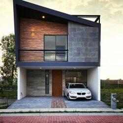 Casa minimalista com estrutura metálica e bloco aparente